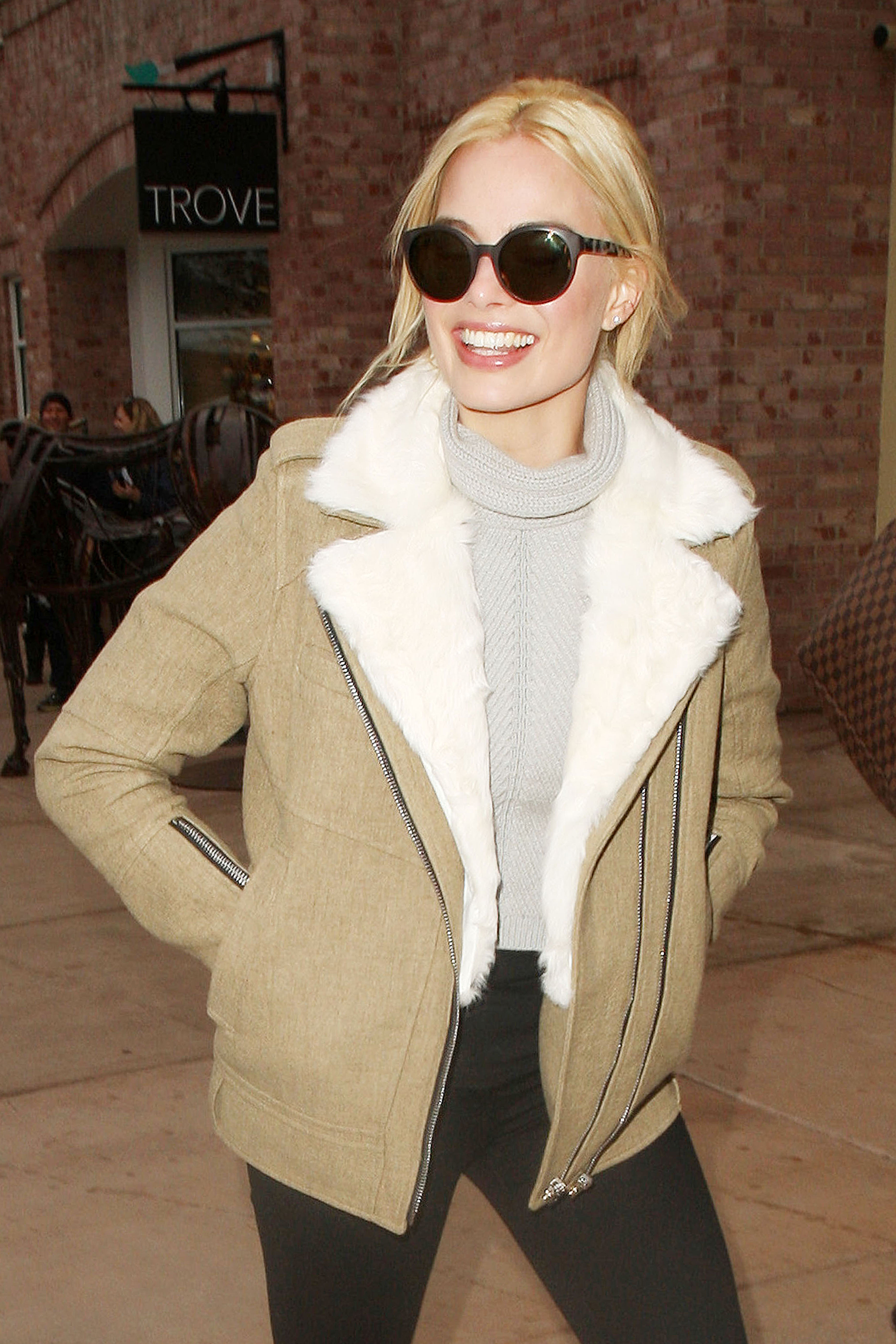 Margot Robbie is all smiles after recent reports of kissing Alexander Skarsgard **USA ONLY**